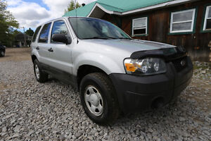 2005 Ford Escape with a 2.3L L4 DOHC 16V