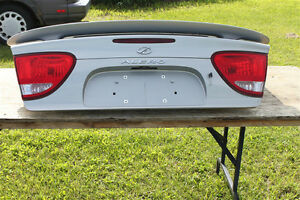 1999 Olds Alero trunk lid with spoiler and tail lights/ silver
