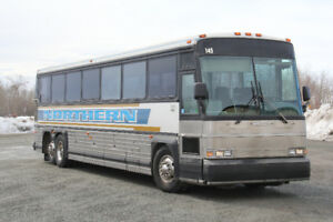 Highway Coach; MCI 102C3. Detroit 50 Series.