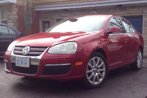 2006 VW 2.0L Turbo, SunRoof, 232 Kms, Red 4dr with new paint.