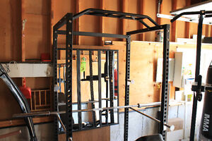 SELLING ENTIRE GYM, MOVING SALE SQUAT RACK/PUNCHING BAGS/WEIGHTS