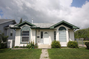 Fully Finished Bungalow beside Park in Innisfail