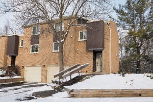 Stunning condo backing onto quiet treed area