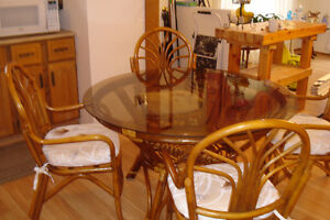 RATTAN TABLE WITH 48 INCH GLASS TOP AND 4 RATTAN CHAIRS