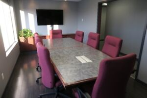 Boardroom table and office chairs