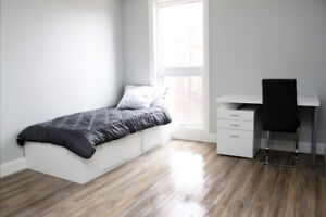 Individual rooms with en-suite washrooms and shared common area,