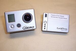 GoPro HD video camera with numerous accessories.