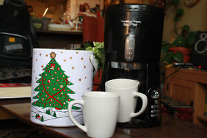 coffee maker, 2 white matching mugs and a christmas ice bucket