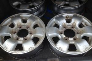 """(4) Nissan 15"""" six stud rims, great for winter!"""