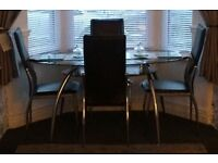 Black glass oval dining table (chairs not included)