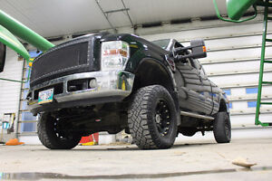 2008 Ford F-250 Pickup Truck with lift kit and rims! Safetied!