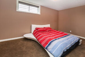 Next to new White leather bed frame and brand new queen mattress