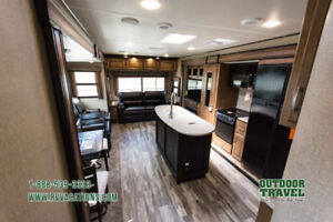 2017 38 ft travel trailer set up in a park in bobcaygeon