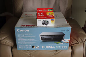 NEW CANON PRINTER -  PLUS A SELPHY CP740