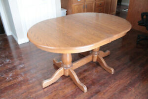 Solid wood dining table with two large leaves