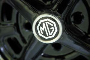 4 Pneus MG avec Mags 14p. comme neuf A VENDRE