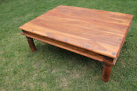 Heavy imported wood character coffee table