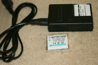Olympus model # LI-50CAA battery charger with 2 batteries