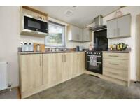 Beautiful lodge on a quiet park, comes with a large decking. Choose your plot.