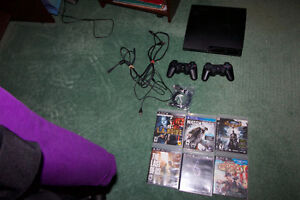 PS3 with 2 Controllers and 6 Games
