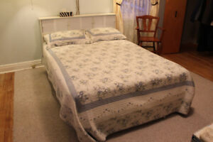 Double bed with white storage headboard