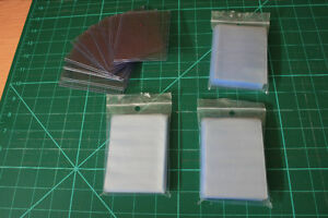 10 Thick Card Protectors and 3x100 Packages of Slim Protectors