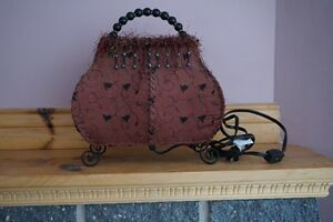 Purse shaped table lamp