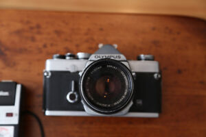 Olympus OM-1 with 28mm, 200mm, 50mm, 85-205mm Lens, Accessories