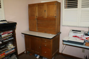 antique oak cabinet with rolled up section complete with shelves