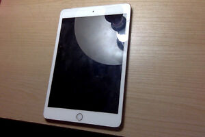 Looking to trade iPad Mini 4 (Gold) for iPhone 6 West Island Greater Montréal image 3