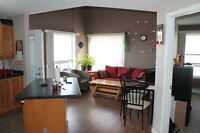 Corner Bi-level condo FOR SALE BY OWNER in very popular location