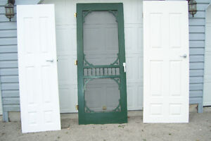 THREE SOLID WOOD DOORS TWO INTERIOR ONE FANCY SCREEN DOOR