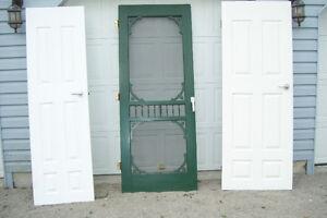 THREE SOLID WOOD DOORS TWO INTERIOR ONE FANCY SCREEN DOOR London Ontario image 1