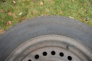 Practically new: 4 snow tires on steel rims 205/70/R15 Kitchener / Waterloo Kitchener Area image 1