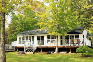 BEAUTIFUL COTTAGE ON CROWE RIVER WITH HOT TUB