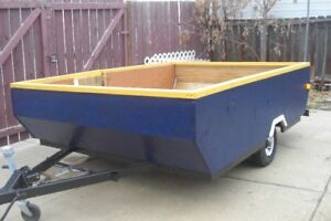 NICE 6.6 FT X 8 FT GUTTED TENT TRAILER WITH A COVER