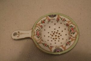 Antique Porcelain Tea Strainer