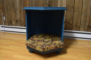 Blue end table with cat or dog bed underneath