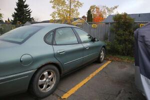 2005 Ford Taurus (plus 4 tires off rims)