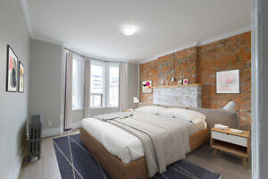 Renovated 2 Bed Suite with Exposed Brick & Balcony