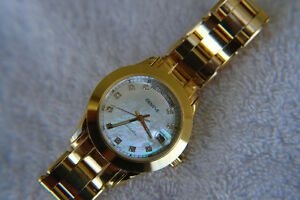 INVESTMENT BEAUTY, 4.6 OZ 18K SOLID GOLD WATCH