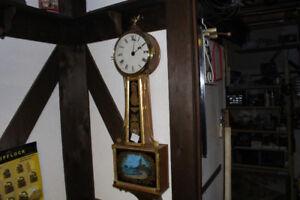 Beautiful antique weight driven banjo clock
