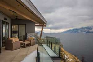 LUXURY LIVING with panoramic views of Lake Okanagan.