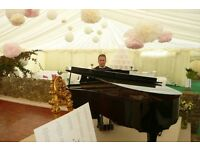 Professional pianist for weddings and events- with white piano shell