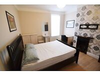 Double room available in friendly shared house near city center bills included
