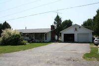 House for sale with 2 car garage and attached workshop