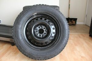 Winter Tires 245/60/R18 directional with studs, on rims