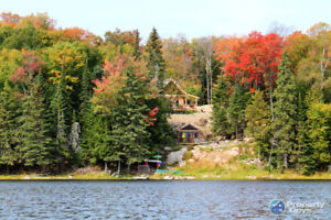 NEW PRICE - Log Home with 12.5ac - Private Lakefront Property