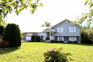Sitting on private 1 acre lot...2 garages