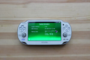 White PS Vita Barely Used (Old Firmware)